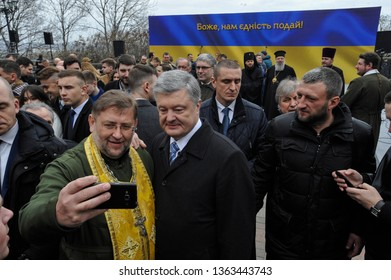 KYIV, UKRAINE- March 30, 2019: Ukraine's President Petro Poroshenko poses for a photo with Ukrainians after the  praying for fair elections.