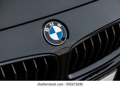 Kyiv, Ukraine - March 4th, 2017: Bmw motor company badge on the front from a black car. BMW is a German automobile, motorcycle and engine manufacturing company founded in 1916