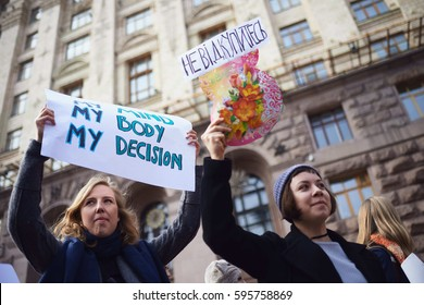 KYIV, UKRAINE - MARCH 8, 2017: Women hold a placards during a rally for gender equality and against violence towards women on International Women's Day in Kyiv.