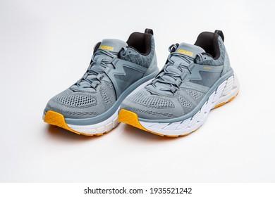 Kyiv, UKRAINE - march12 , 2021: Studio product advertisment shot of Hoka Gaviota 2 running shoes on a white backround