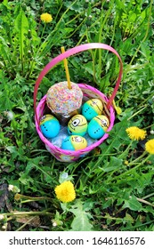 Kyiv, Ukraine, May 1, 2016 - basket with Easter eggs. basket with colored Easter eggs minions on green grass.