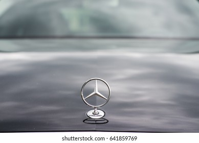 Kyiv, Ukraine - May 15th, 2017: Mercedes-Benz badge on the car's bonnet. Close-up photo