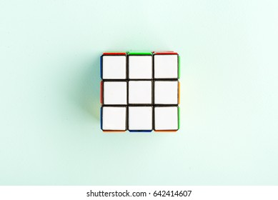 Kyiv, Ukraine - May 17th, 2017: Rubik's cube on the light blue background, top view. Rubik's cube invented by a Hungarian architect Erno Rubik in 1974.