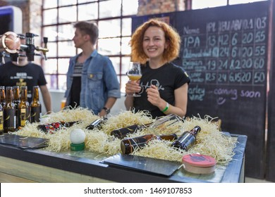 KYIV, UKRAINE - MAY 18, 2019: Bartenders work at Copper Head beer brewery booth during Kyiv Beer Festival vol. 4 in Art Zavod Platforma. More than 60 craft beer breweries were presented here.