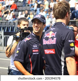 KYIV, UKRAINE - MAY 19, 2012: Driver Daniel Ricciardo of Red Bull Racing Team looks on during Red Bull Champions Parade on the streets of Kyiv city
