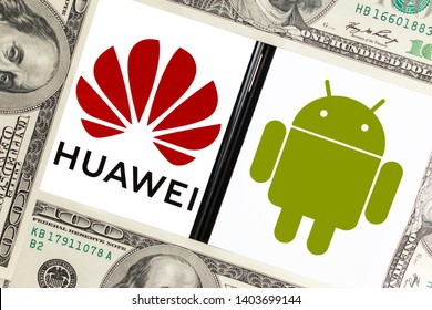 Kyiv, Ukraine – May 21, 2019: Logos of Huawei Technologies and Google Android mobile operating system on the screens of the smartphones framed by dollar bills. Google revoked Huawei's Android license