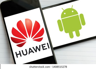 Kyiv, Ukraine – May 21, 2019: Huawei Technologies and Android operating system logos on screens of the modern smartphones. The future of Huawei without Android