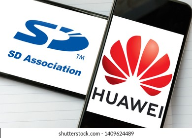 Kyiv, Ukraine – May 21, 2019: Logos of SDCardAssociation and Huawei Technologies placed on the phone screens. Huawei was kicked out from SD Association, Wi-Fi Alliance, and other standard groups