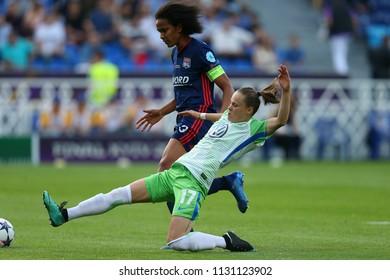 KYIV, UKRAINE - MAY 24, 2018: Ewa Pajor attacks the goal and shoots the ball during sliding tackle. UEFA Women's Champions League final Wolfsburg-Lyon
