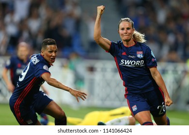 KYIV, UKRAINE - MAY 24, 2018: Amandine Henry celebrates scored goal with Shanice van de Sanden. UEFA Women's Champions League final Wolfsburg-Lyon