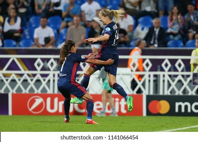 KYIV, UKRAINE - MAY 24, 2018: Ada Hegerberg and Amel Majri celebrating scored goal with spectacular emotions. UEFA Women's Champions League final Wolfsburg-Lyon