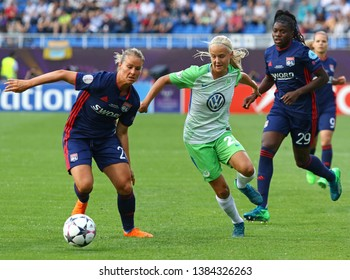 KYIV, UKRAINE - MAY 24, 2018: Amandine Henry of Olympique Lyonnais (L) fights for a ball with Pernille Harder of VFL Wolfsburg during their UEFA Women's Champions League Final 2018 game in Kyiv