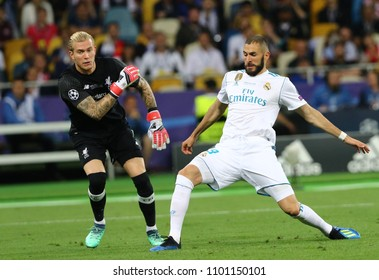 KYIV, UKRAINE - MAY 26, 2018: Karim Benzema of Real Madrid (R) scores a 1st goal during the UEFA Champions League Final 2018 game against Liverpool at NSC Olimpiyskiy Stadium in Kyiv, Ukraine