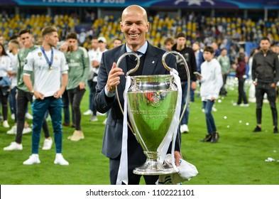 KYIV, UKRAINE - MAY 26, 2018: Zinedine Zidane celebrates and holds the UEFA Champions League trophy during the 2018 UEFA Champions League final match between Real Madrid and Liverpool, Ukraine