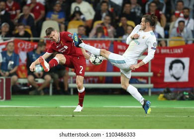 KYIV, UKRAINE - MAY 26, 2018: James Milner shoots the ball performs high cross pass, Gareth Bale pressure in defense, blocks the shot. UEFA Champions League final Real Madrid - Liverpool. Olympic NSC