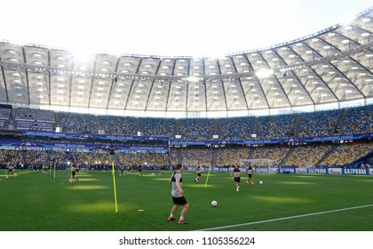 KYIV, UKRAINE - MAY 26, 2018: Liverpool players run on the pitch during training session before UEFA Champions League Final 2018 game against Real Madrid at NSC Olimpiyskiy Stadium in Kyiv, Ukraine