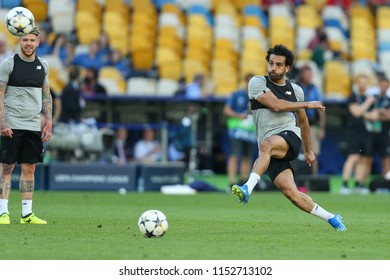 KYIV, UKRAINE - MAY 26, 2018: Liverpool top-player, leader and best scorer Mohamed Salah shoots the ball. UEFA Champions League final Liverpool pre-match training. Olympic NSC stadium.