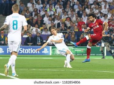 KYIV, UKRAINE - MAY 26, 2018: Mohamed Salah of Liverpool (R) kicks a ball during the UEFA Champions League Final 2018 game against Real Madrid at NSC Olimpiyskiy Stadium. Real Madrid won 3-1