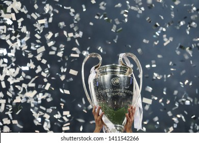 KYIV, UKRAINE – MAY 26, 2018: Champions League cup in the hands of the winner, confetti on the background. UEFA Champions League final between Real Madrid and Liverpool. NSC Olympic stadium in Kyiv.