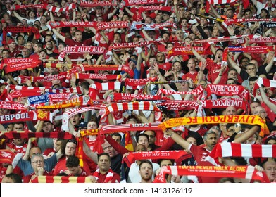 KYIV, UKRAINE – MAY 26, 2018: Liverpool football club fans sing 'You'll never walk alone' during UEFA Champions League final between Real Madrid and Liverpool. NSC Olympic stadium in Kyiv.