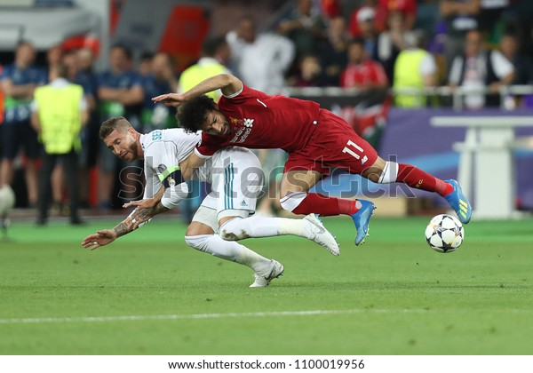 KYIV, UKRAINE - MAY 26, 2018: Mohamed Salah gets injury after tough tackle by Sergio Ramos. UEFA Champions League final Real Madrid - Liverpool. Olympic NSC stadium.