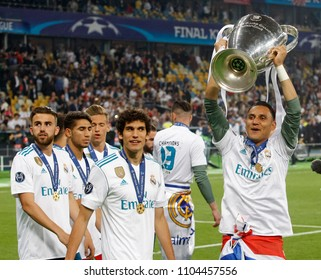 KYIV, UKRAINE - MAY 26: Keylor Navas (R) of Real Madrid lifts the trophy as team celebrate winning the Champions League final match between Real Madrid vs Liverpool FC in Kiev on 26 May 2018