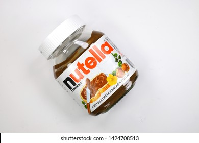 Kyiv, Ukraine - May 27, 2019: Nutella introduced to the market in 1964 by Italian company Ferrero. Nutella hazelnut on white background