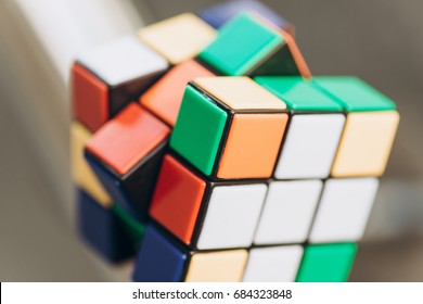 Kyiv, Ukraine - May 28th, 2017: Rubik's cube on blurred background. Rubik's cube invented by a Hungarian architect Erno Rubik in 1974.