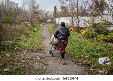 KYIV, UKRAINE - November 13, 2012. The settlement of Roma in the residential district of Kiev. Gypsy collects scrap metal