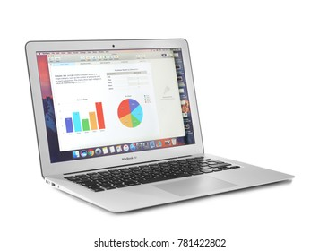 KYIV, UKRAINE - NOVEMBER 13, 2017: Apple MacBook Air Silver displaying opened document on white background, designed and developed by Apple Inc