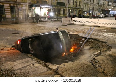 Kyiv, Ukraine - November 13, 2018: Uber car partially collapsed under the ground after pipe with hot water breakthroughs on Shota Rustaveli street in the center of Kyiv city