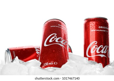 KYIV, UKRAINE - NOVEMBER 14, 2017: Cans of Coca-Cola with ice cubes, isolated on white