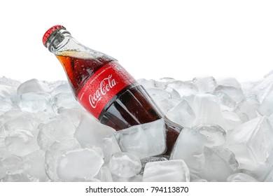 KYIV, UKRAINE - NOVEMBER 14, 2017: Bottle of Coca-Cola with ice cubes, isolated on white