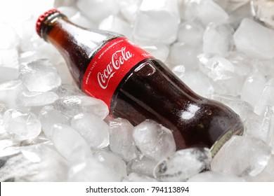 KYIV, UKRAINE - NOVEMBER 14, 2017: Bottle of Coca-Cola on ice cubes, closeup