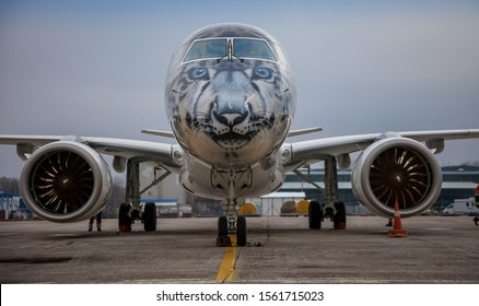 Kyiv, Ukraine - November 14, 2019: Airplane Embraer-190-E2 in the snow leopard livery. Airbrushing on the cockpit, livery - coloring by plane. Air Astana Kazakhstan. Boryspil International Airport.
