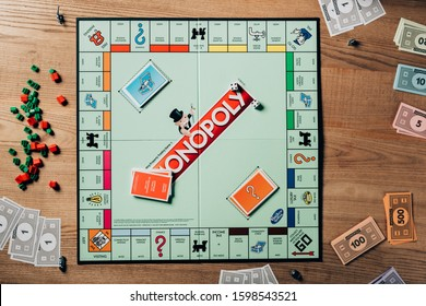 KYIV, UKRAINE - NOVEMBER 15, 2019: Top view of monopoly game on wooden table