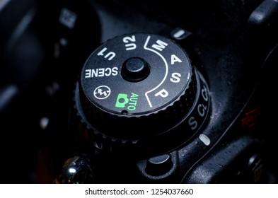 Kyiv, Ukraine - November 20, 2018: Nikon digital camera mode dial close-up.