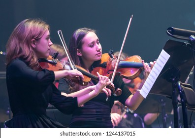 "KYIV, UKRAINE - NOVEMBER 22, 2018: Violinists of Symphony Orchestra (conductor Andrey Chernyi) perform on stage during ""The Game of Thrones"" concert at National Palace of Arts ""Ukraina"" in Kyiv"