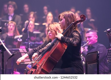"KYIV, UKRAINE - NOVEMBER 22, 2018: Symphony Orchestra (conductor Andrey Chernyi) performs soundtracks from ""The Game of Thrones"" on a stage of National Palace of Arts ""Ukraina"" in Kyiv, Ukraine"