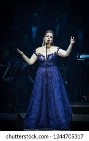 """KYIV, UKRAINE - NOVEMBER 22, 2018: Singer performs on stage during """"The Game of Thrones"""" Symphony Orchestra concert at National Palace of Arts """"Ukraina"""" in Kyiv"""