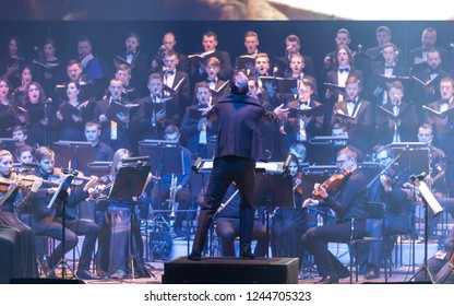 "KYIV, UKRAINE - NOVEMBER 22, 2018: Symphony Orchestra (conductor Andrey Chernyi) and Choir ""Voice of the Sympho Rock"" perform soundtracks from ""The Game of Thrones"" on stage of National Palace of Arts"