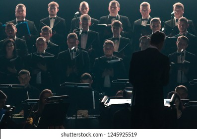 "KYIV, UKRAINE - NOVEMBER 22, 2018: Choir ""Voice of the Sympho Rock"" perform soundtracks from ""The Game of Thrones"" on stage of National Palace of Arts ""Ukraina"" in Kyiv, Ukraine"