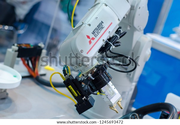Kyiv, Ukraine - November 22, 2018: Mitsubishi Electric robot arm.