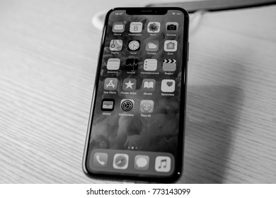 KYIV, UKRAINE - NOVEMBER 27, 2017: Presentation of the iPhone X in the Citrus store. A man holds an iPhone X. black and white photo