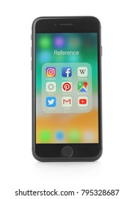 KYIV, UKRAINE - NOVEMBER 28, 2017: Front view of Space Gray iPhone 8 with icons on screen, isolated on white