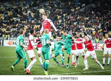 KYIV, UKRAINE - NOVEMBER 29, 2018: FC Vorskla Poltava (in Green) and Arsenal players fight for a ball during their the UEFA Europa League game at NSC Olimpiyskyi stadium in Kyiv. Arsenal won 3-0