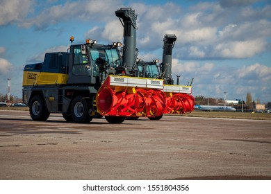 "Kyiv, Ukraine - November 5, 2019:  Snowplow ""Snowbooster B6"" - a small powerful tractor for cleaning roads and airdromes from snow in the winter. Modern and powerful snow thrower. Boschung company."