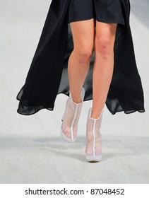 "KYIV, UKRAINE - OCT. 14: Model walks the runway during Fashion Show by ""BEVZA"" as part of Ukrainian Fashion Week, October 14, 2011 in Kyiv, Ukraine."