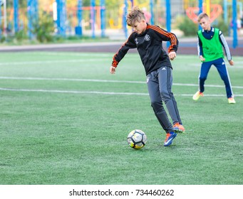 Kyiv, Ukraine -October 10th 2017. Adidas, Gera and Nike uniform with Manchester United and UEFA logos on boys playing football on the field. Adidas, Gera and Nike  are sportswear corporations.