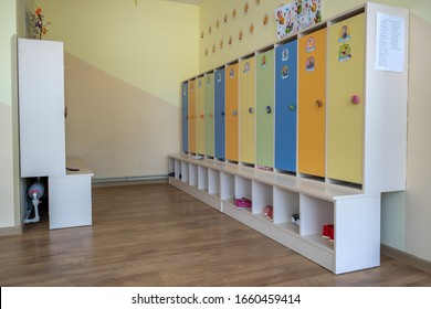 Kyiv, Ukraine - October 14, 2019: Interior of a spacious kindergarten room with small children lockers for clothing and shoes keeping.